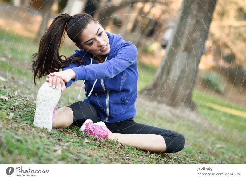 Young woman stretching after running outdoors. Lifestyle Beautiful Wellness Sports Human being Woman Adults Park Brunette Fitness Cute White young Practice