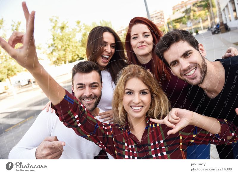 Group of friends taking selfie in urban park Lifestyle Joy Happy Beautiful Leisure and hobbies Telephone PDA Camera Human being Masculine Woman Adults Man