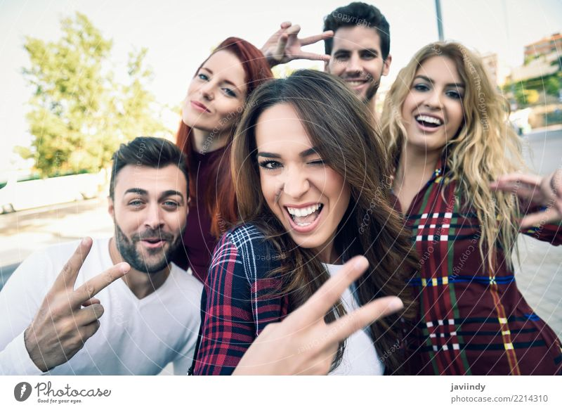 Group of friends taking selfie in urban park Lifestyle Joy Happy Beautiful Leisure and hobbies Telephone PDA Camera Masculine Feminine Woman Adults Man