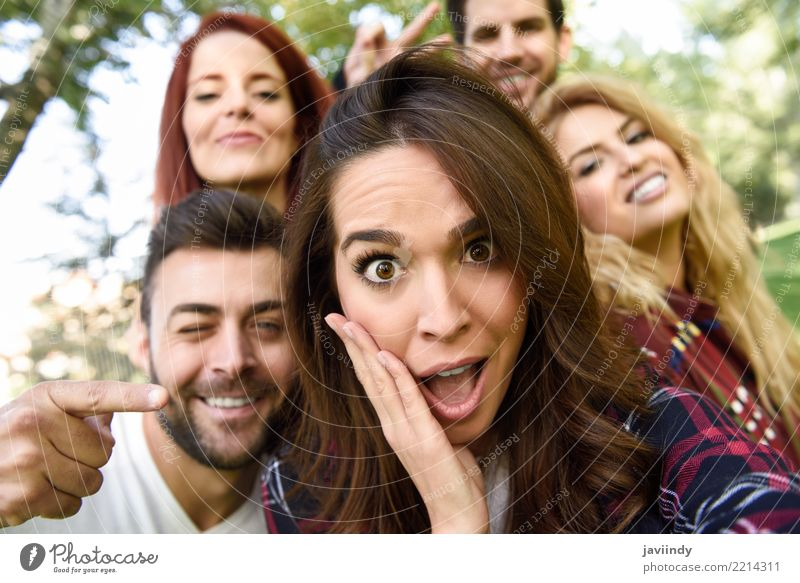 Group of friends taking selfie in urban park Lifestyle Joy Happy Beautiful Leisure and hobbies Telephone PDA Camera Human being Masculine Feminine Woman Adults