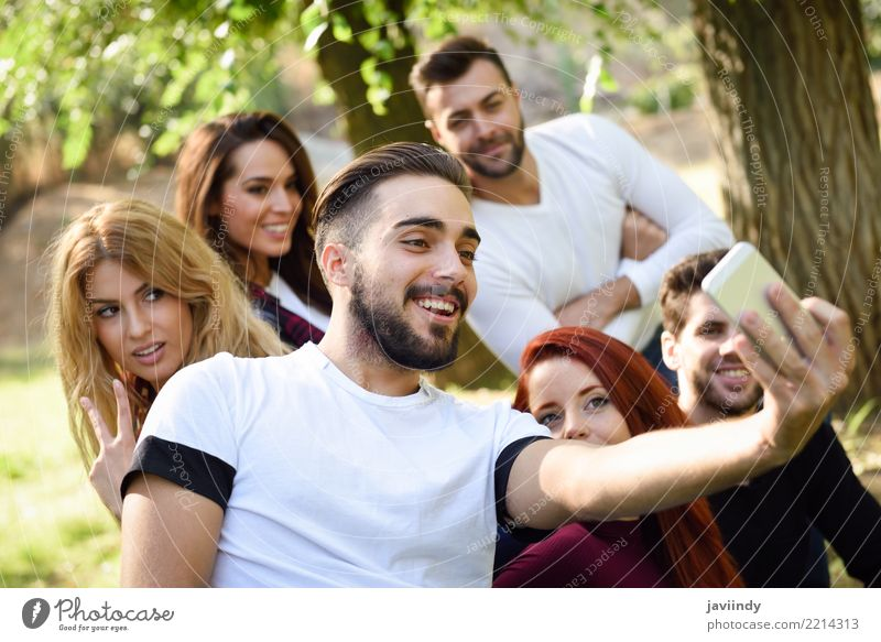 Group of friends taking selfie in urban park Lifestyle Joy Happy Beautiful Leisure and hobbies Telephone PDA Camera Woman Adults Man Friendship 6 Human being