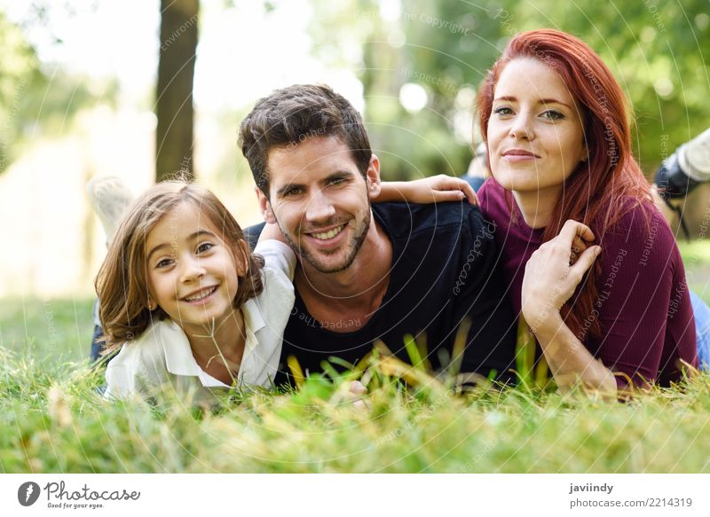 Happy young family in a urban park. Child Woman Human being Nature Youth (Young adults) Man Summer Beautiful Joy 18 - 30 years Adults Lifestyle Autumn Love