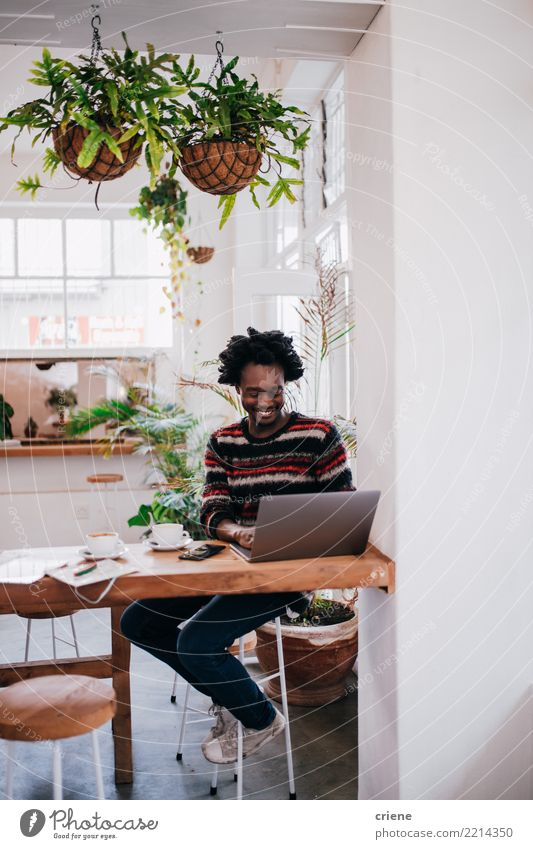 Young African American businessman working with laptop in cafe Breakfast Beverage Drinking Coffee Espresso Lifestyle Restaurant Work and employment Workplace