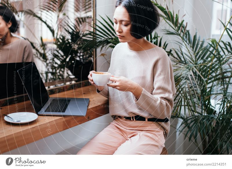 Confident young asian businesswoman drinking coffee in cafe Woman Youth (Young adults) Adults Business Work and employment Technology Sit Creativity Success