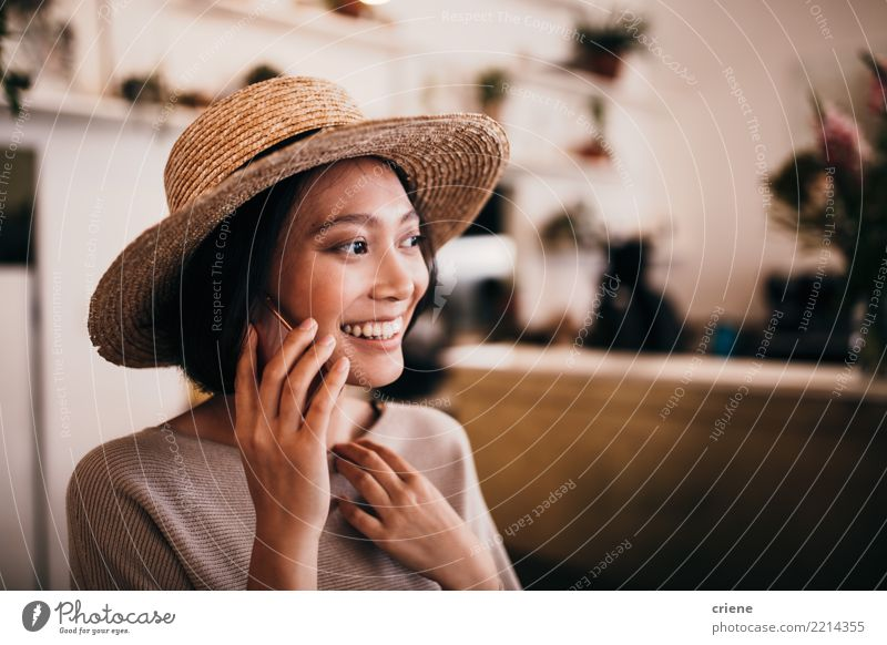 Female asian adult in a conversation on a call Woman Human being Youth (Young adults) Young woman Joy 18 - 30 years Adults Lifestyle Emotions Feminine Happy