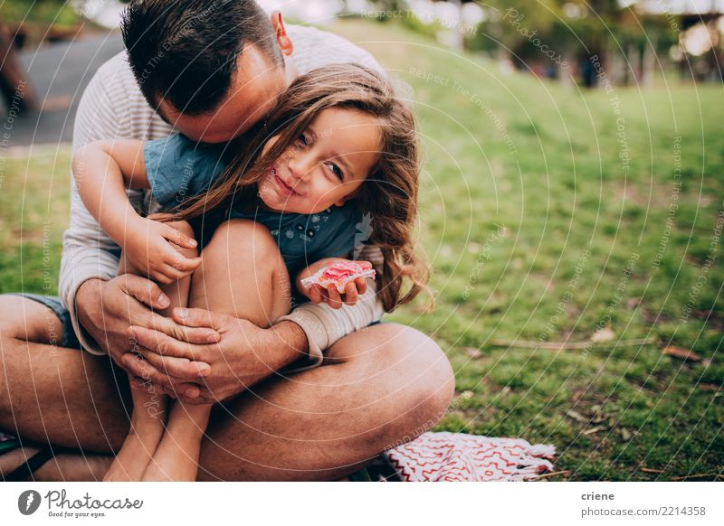 Father and daughter at a picnic in the park Child Human being Joy Girl Eating Adults Lifestyle Meadow Emotions Grass Family & Relations Small Happy Garden Park