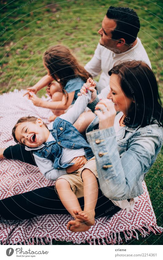 Family with kids having fun at picning in the park Child Woman Human being Joy Adults Lifestyle Meadow Grass Laughter Family & Relations Happy Playing Group