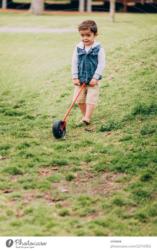 Little toddler boy playing in the garden with toy Child Human being Man Joy Adults Lifestyle Meadow Grass Boy (child) Happy Playing Garden Leisure and hobbies