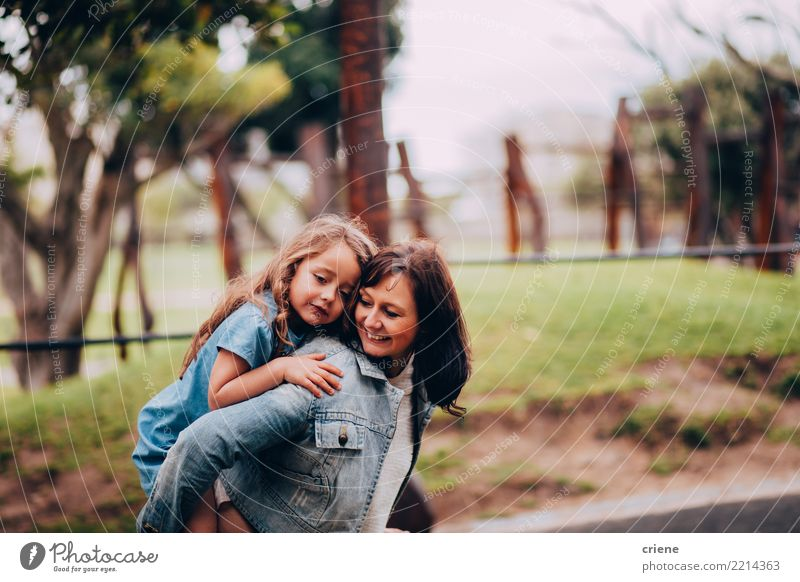 Mother and daughter hugging each other in the park Lifestyle Joy Happy Parenting Human being Feminine Child Girl Woman Adults Parents Family & Relations 2 Park