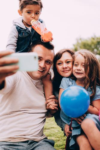 Happy caucasian family taking selfie with phone together Child Woman Human being Man Joy Girl Adults Lifestyle Love Laughter Family & Relations Boy (child)