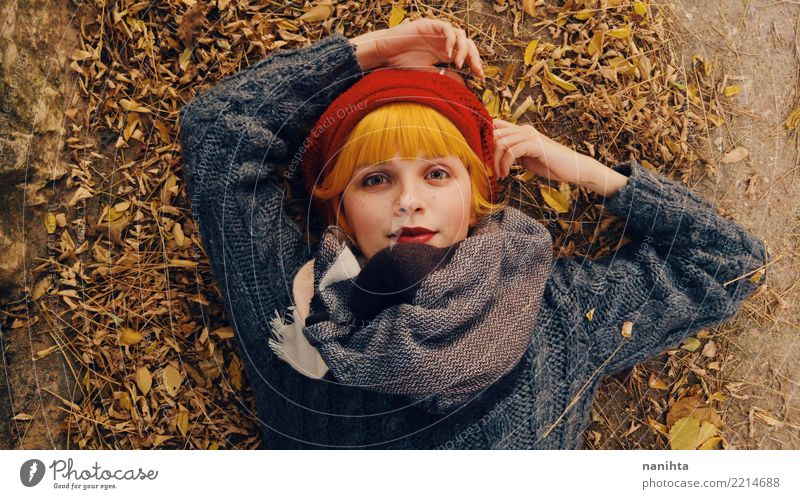 Young redhead woman in an autumn day Human being Nature Youth (Young adults) Young woman Beautiful Relaxation Leaf Joy 18 - 30 years Face Adults Environment