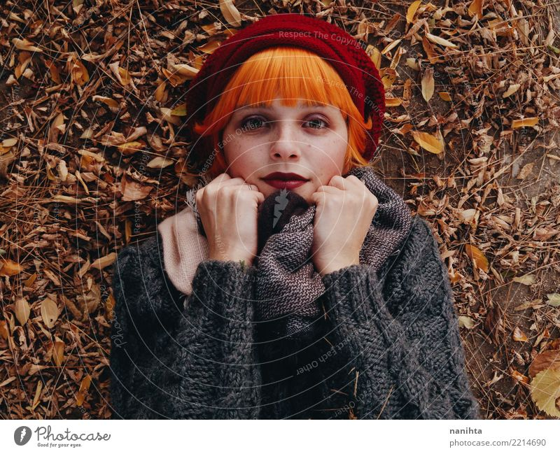 Beautiful and redhead woman in an autumn day Human being Nature Youth (Young adults) Young woman Leaf 18 - 30 years Face Adults Lifestyle Autumn Healthy
