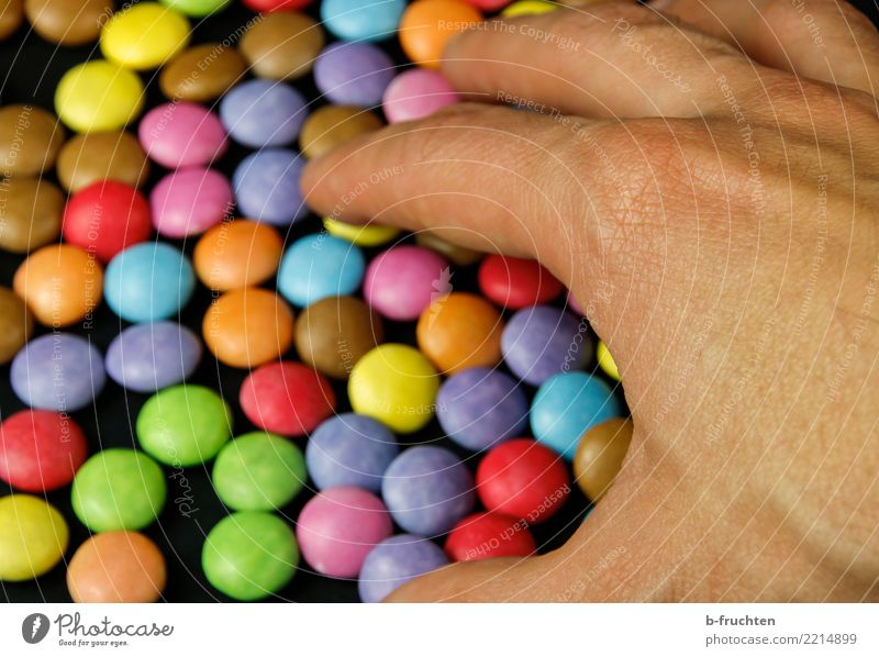 All my colorful pills Candy Man Adults Hand Fingers Touch Multicoloured Gluttony Debauchery Drug addiction To enjoy Chocolate buttons Take Pill Healthy Diet