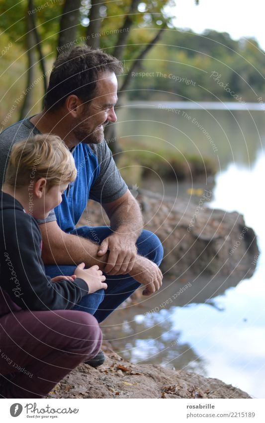 Father and son sit on a lakeside in their free time and have fun Leisure and hobbies Human being Masculine Child Boy (child) Man Adults Parents