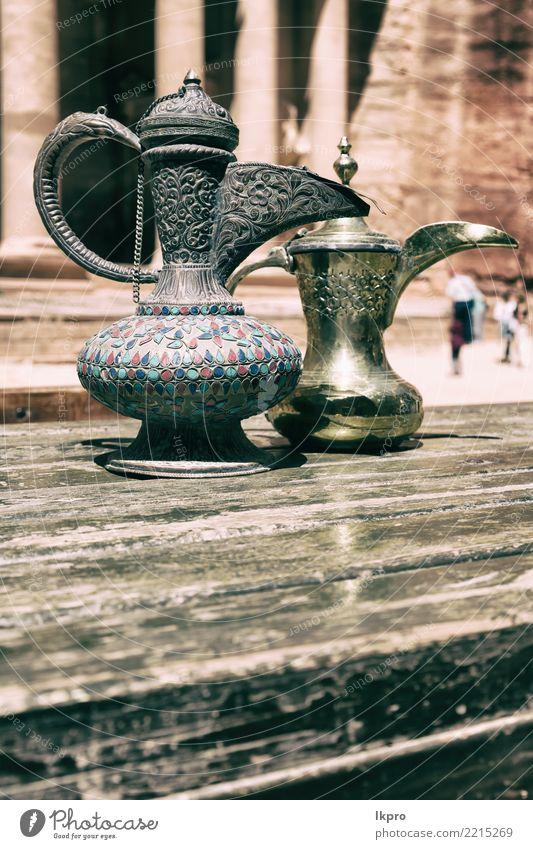in the site of petra jordan the traditional coffe Beverage Coffee Tea Pot Tourism Adventure Table Restaurant Culture Container Souvenir Metal Historic Retro