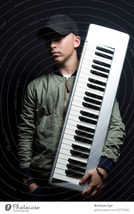 passion Music Human being Masculine Young man Youth (Young adults) 1 13 - 18 years Piano Playing Cool (slang) Large Hip & trendy Black Contentment Interest