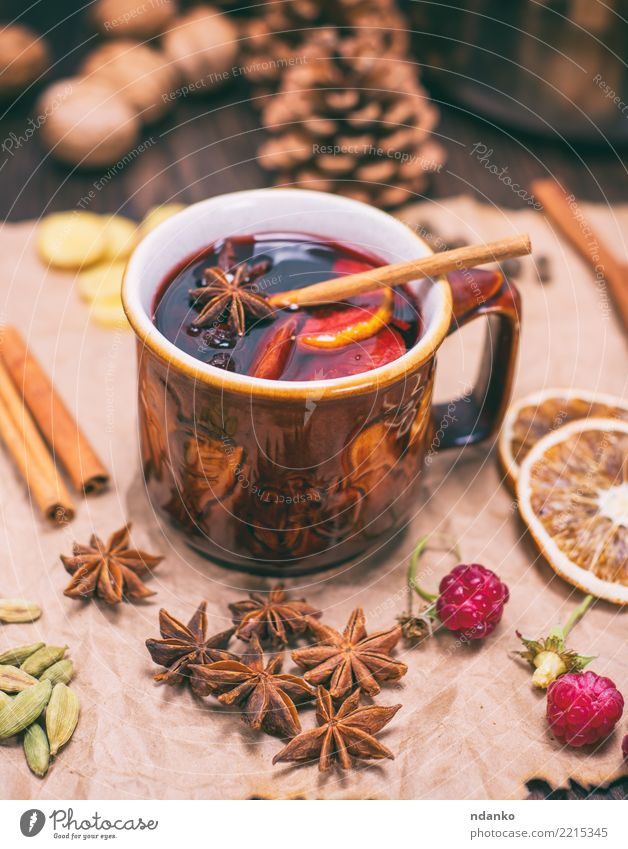 drink mulled wine in brown ceramic mug Christmas & Advent Red Winter Natural Wood Feasts & Celebrations Brown Fruit Decoration Table Paper Herbs and spices