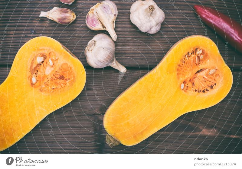 fresh pumpkin and garlic Healthy Eating Yellow Autumn Wood Brown Above Fresh Table Vegetable Seasons Harvest Tradition Dinner Meal Vegetarian diet