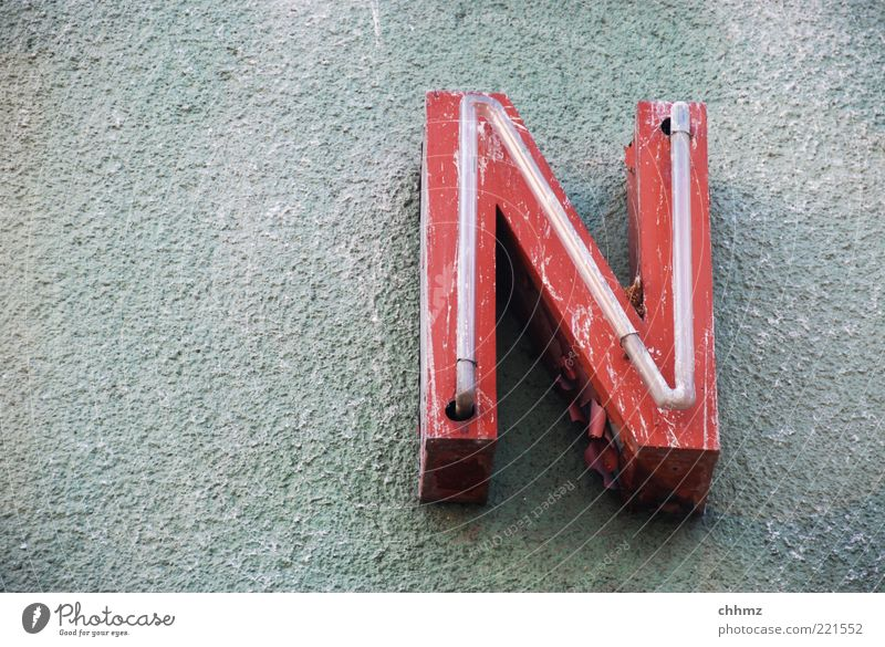 n Glass blower Advertising Industry Wall (barrier) Wall (building) Facade Sign Characters Hang Illuminate Old Red Weathered Flake off Patina Plaster