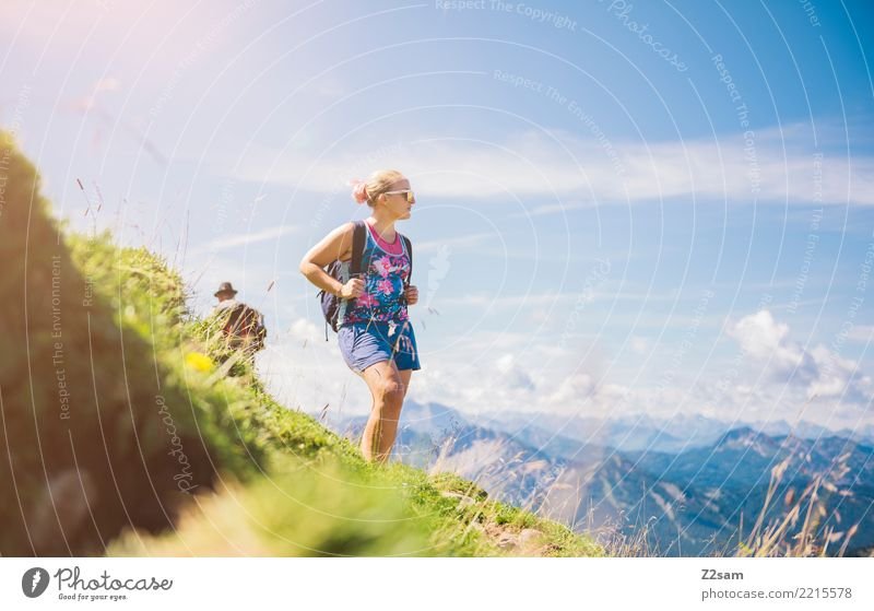 Young woman ascending Leisure and hobbies Adventure Freedom Mountain Hiking Youth (Young adults) 30 - 45 years Adults Nature Landscape Sunlight Summer