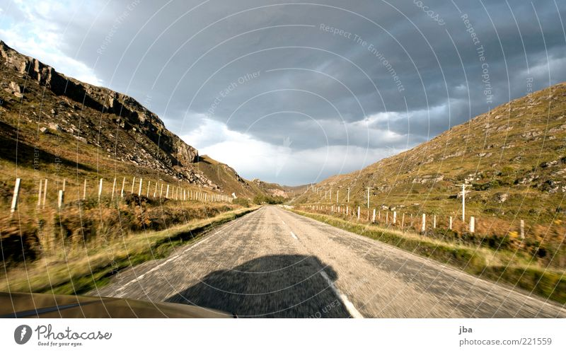 Vacation & Travel Clouds Far-off places Street Autumn Stone Car Transport Speed Tourism Esthetic Driving Asphalt Traffic infrastructure Fence Motoring