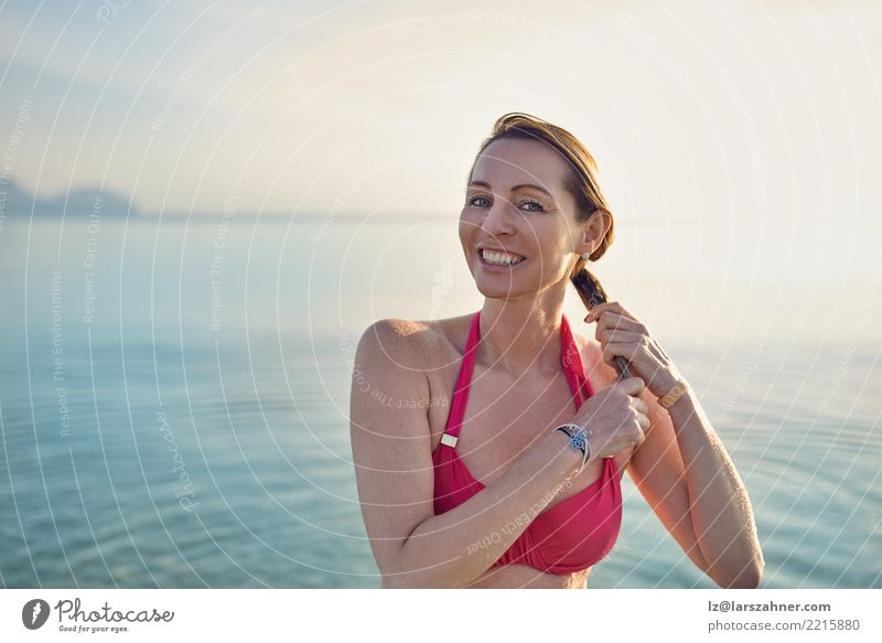 Happy smiling middle-aged woman at the seaside Beautiful Skin Face Wellness Relaxation Vacation & Travel Tourism Summer Beach Ocean Woman Adults 1 Human being