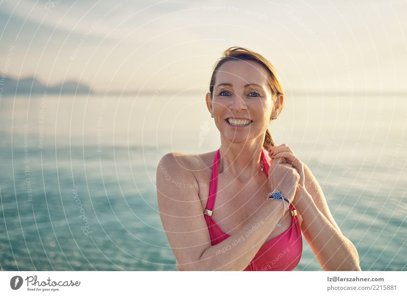Happy smiling middle-aged woman at the seaside Woman Human being Vacation & Travel Old Summer Beautiful Ocean Relaxation Beach Face Adults Warmth Tourism
