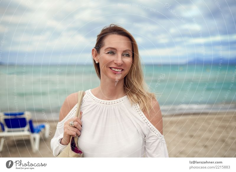 Attractive trendy woman on a tropical resort beach Lifestyle Joy Happy Beautiful Face Vacation & Travel Summer Beach Ocean Woman Adults 1 Human being
