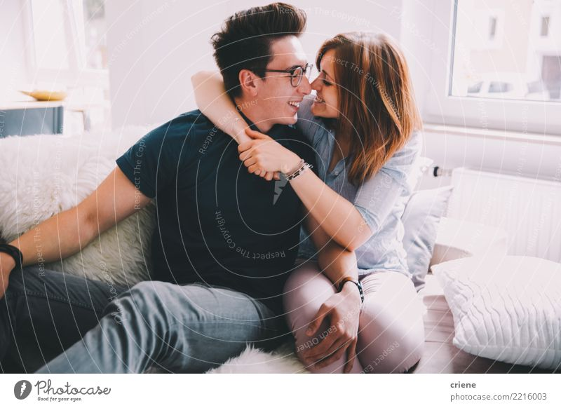 Cute young adult couple having fun at home Woman Youth (Young adults) Man Relaxation House (Residential Structure) Joy Adults Love Emotions Happy Couple