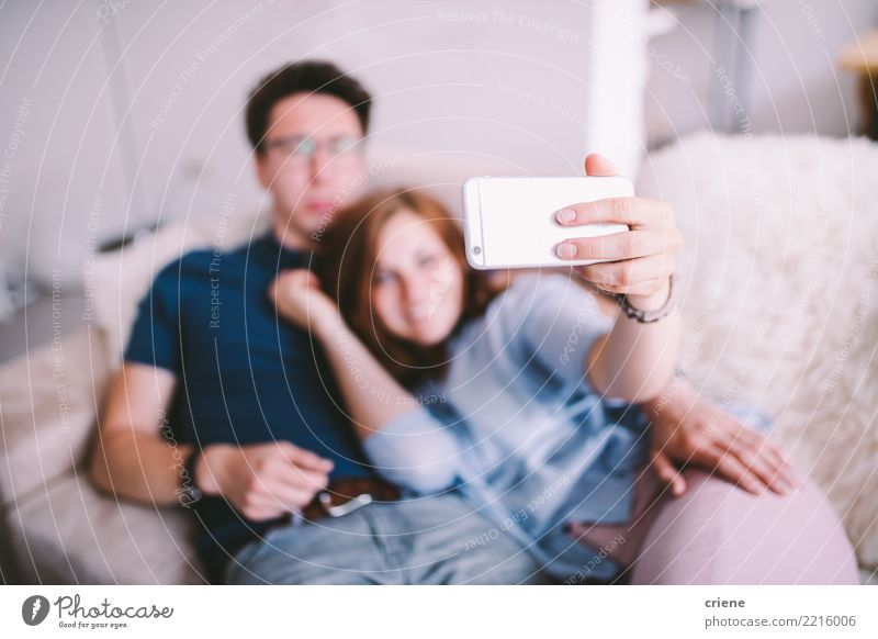 Couple taking selfie with phone at home Joy Happy Telephone Technology Human being Youth (Young adults) Adults Laughter Embrace Together Romance Relationship