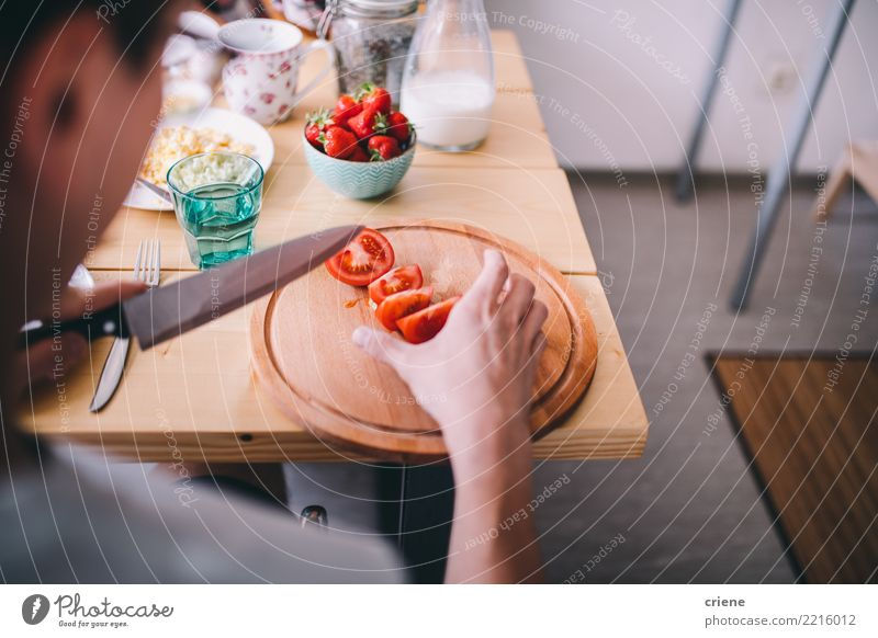 Man cutting tomatoes at breakfast table in the morning Vegetable Eating Breakfast Diet Healthy Eating House (Residential Structure) Table Kitchen Adults