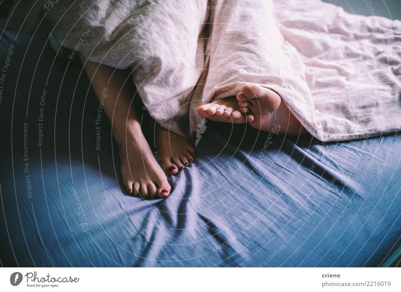 Close-up of couple cuddle in the bed Pedicure Relaxation House (Residential Structure) Bedroom Human being Woman Adults Man Couple Feet Love Embrace Together