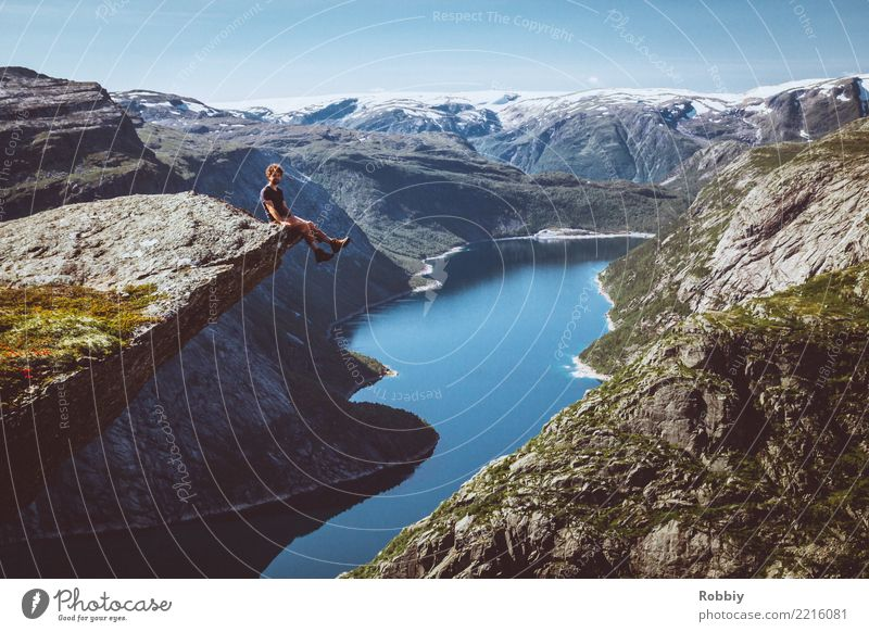 Those who do not climb mountains cannot look into the distance II Masculine 1 Human being Landscape Rock Mountain Peak Bay Fjord Lake Norway Vacation in Norway