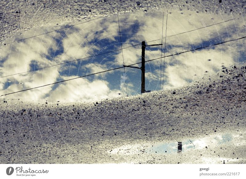 puddle of clouds Water Sky Clouds Blue Gray Black White Electricity pylon High voltage power line Telegraph pole Telephone line Puddle Colour photo