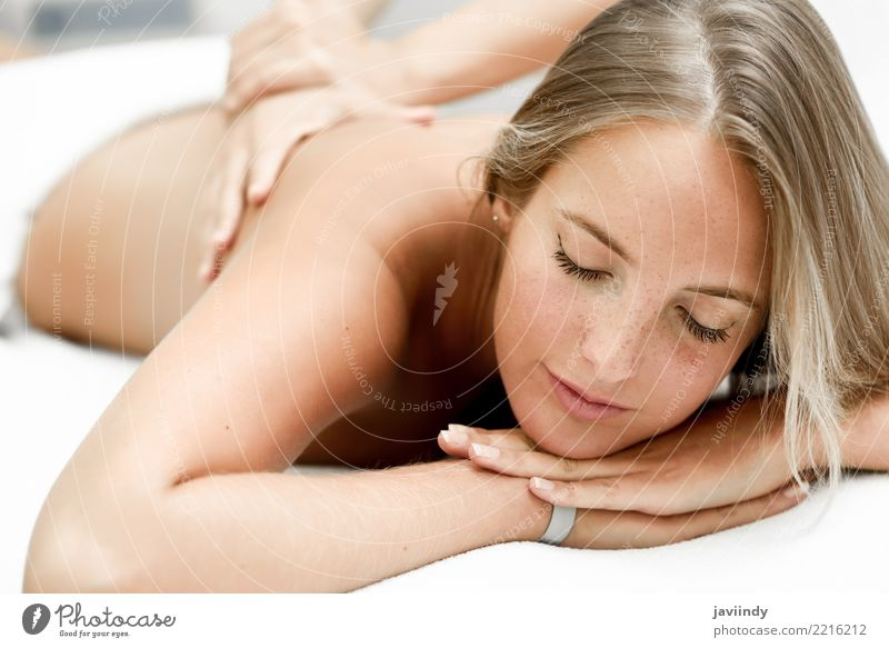 Young blond woman having massage in the spa salon. Lifestyle Happy Beautiful Body Skin Face Health care Medical treatment Wellness Relaxation Spa Massage