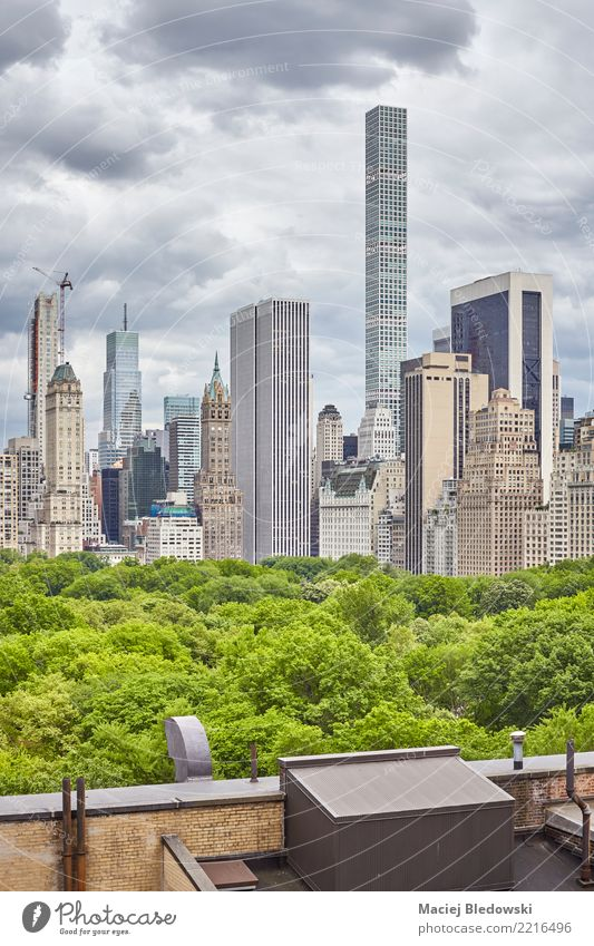 New York City skyline with stormy clouds. Summer Living or residing Flat (apartment) Office Sky Storm clouds Tree Skyline High-rise Roof Authentic Luxury