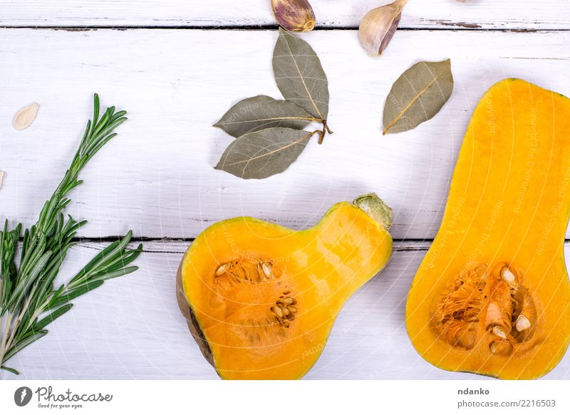 fresh pumpkin Vegetable Herbs and spices Nutrition Eating Lunch Dinner Vegetarian diet Diet Decoration Table Hallowe'en Nature Autumn Wood Fresh Natural Yellow