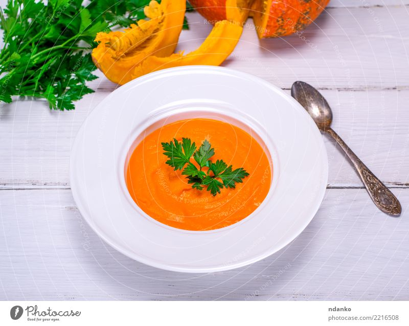 Pumpkin soup puree Vegetable Soup Stew Eating Lunch Dinner Organic produce Vegetarian diet Diet Plate Spoon Table Autumn Wood Fresh Hot Above Yellow White