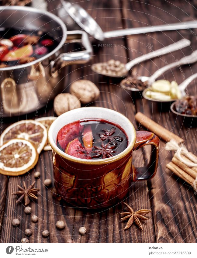 Mulled wine in brown mug Fruit Herbs and spices Beverage Alcoholic drinks Cup Spoon Winter Table Feasts & Celebrations Christmas & Advent Wood Hot Natural Brown