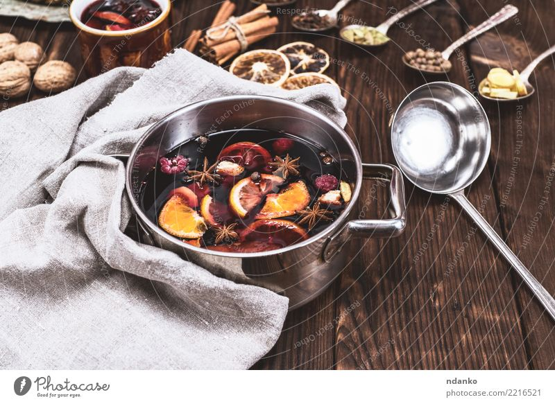 mulled wine in a pan Christmas & Advent Winter Dish Wood Feasts & Celebrations Brown Above Fruit Table Herbs and spices Beverage Hot Tradition Cooking