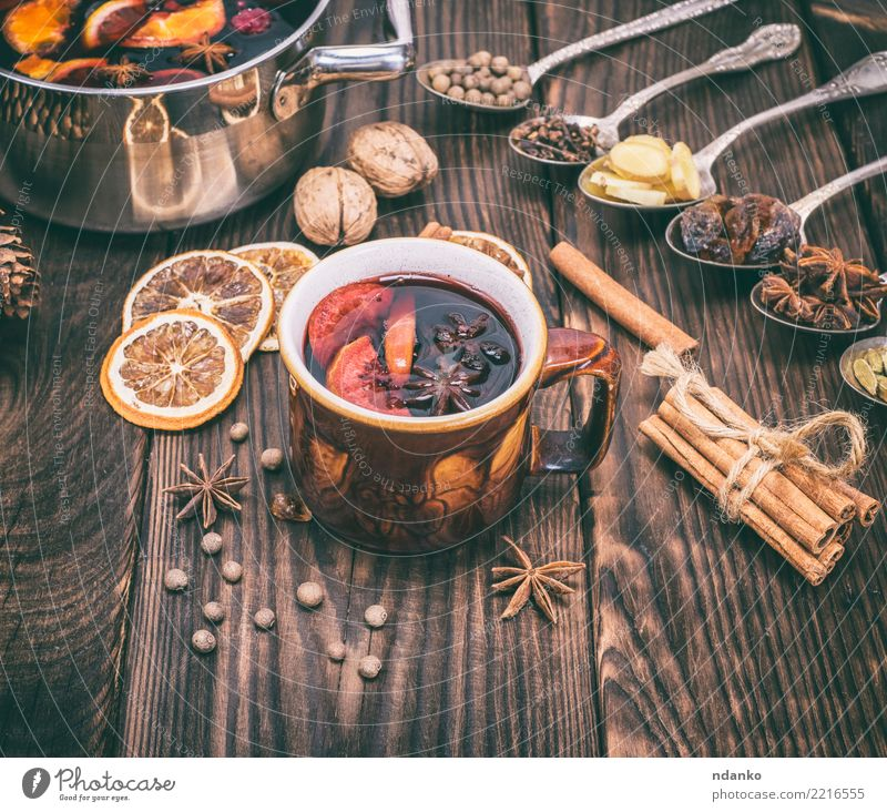 mulled wine in a brown cup Fruit Herbs and spices Beverage Alcoholic drinks Mulled wine Cup Spoon Winter Decoration Table Feasts & Celebrations