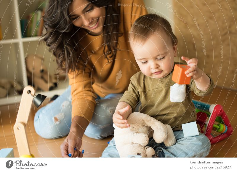Mother playing with her baby - education methods concept Child Woman Beautiful House (Residential Structure) Joy Adults Family & Relations Small Happy Playing