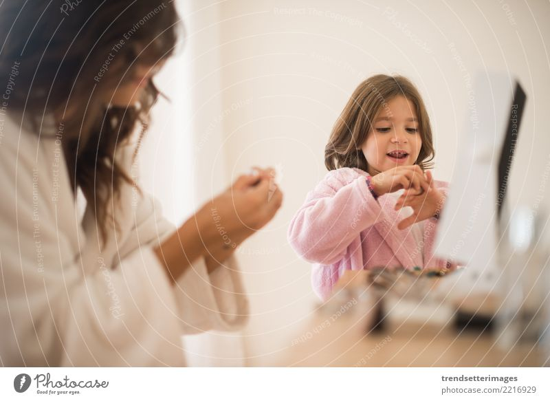Little girl playing with her mother jewellery and make up Elegant Happy Beautiful Cosmetics Mirror Child Mother Adults Infancy Fashion Jewellery Smiling Small