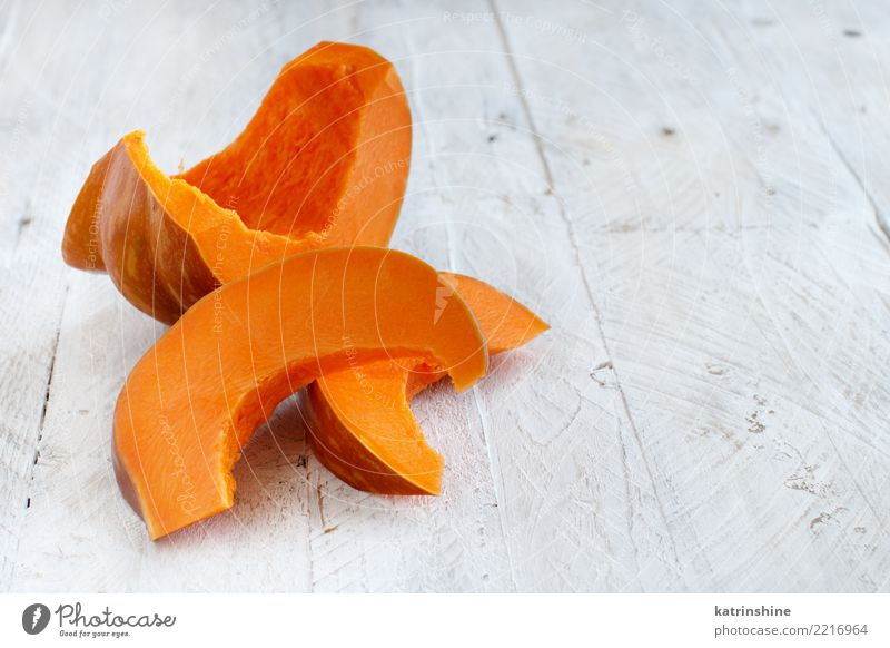 Pumpkin slices on a white wooden background Eating Yellow Autumn Natural Copy Space Nutrition Fresh Vegetable Seasons Farm Harvest Meal Slice Vegetarian diet