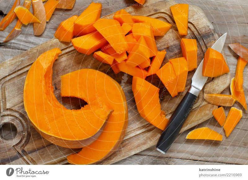 Pumpkin slices on a white wooden background Eating Yellow Autumn Natural Nutrition Fresh Vegetable Seasons Farm Harvest Meal Slice Vegetarian diet Hallowe'en