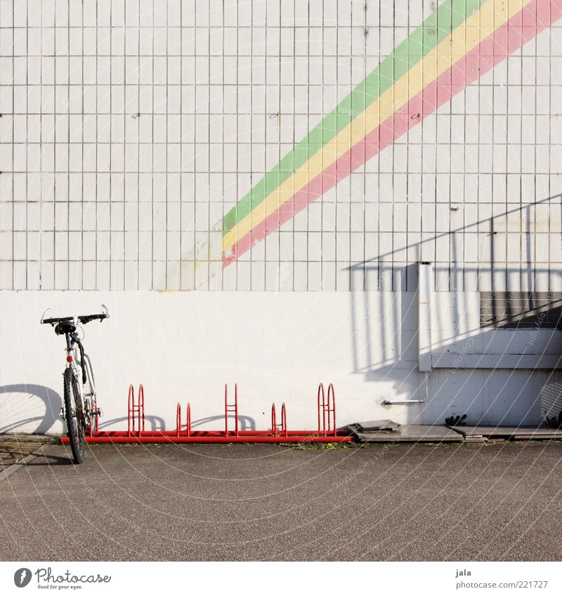 Drive with me to pan Africa. Bicycle Manmade structures Building Facade Tile Places Bicycle rack Stripe Colour photo Deserted Copy Space top Day Light Shadow
