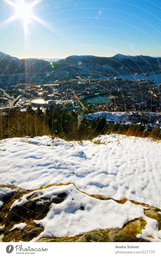 Bergen - Norway Far-off places Freedom Landscape Sky Horizon Sun Beautiful weather Snow Mountain Fjord Europe Town Populated Freeze To enjoy Illuminate Blue