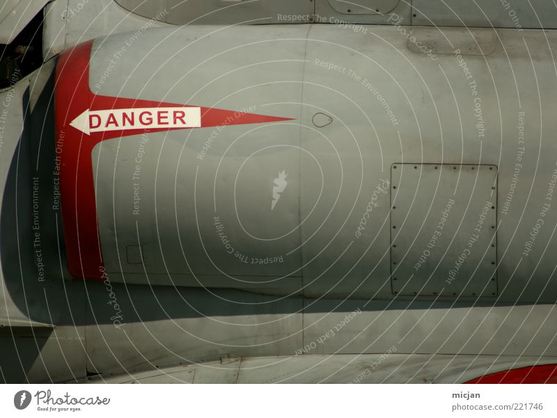 Danger Execution Jet. Aviation Airplane Sign Characters Signs and labeling Signage Warning sign Arrow Stripe Threat Fighter jet Jet fighter Jet engine Metal