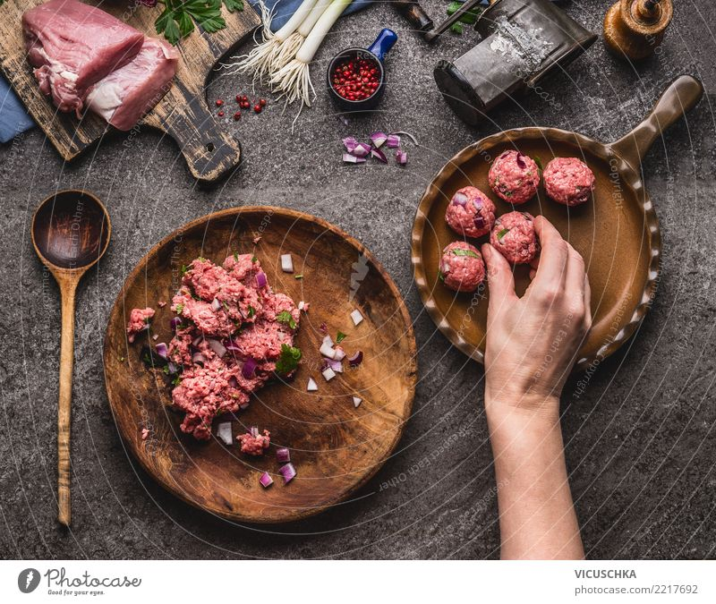 Hand puts meatballs in the pan Food Meat Nutrition Lunch Dinner Organic produce Plate Pan Spoon Style Design Living or residing Feminine Wooden spoon