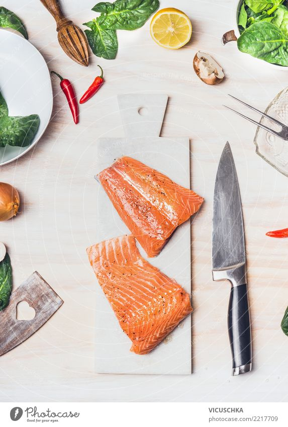 Salmon fillet on cutting board with knife Food Fish Vegetable Lettuce Salad Herbs and spices Nutrition Lunch Dinner Organic produce Diet Crockery Knives Style